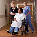 Regions Hospital - Burn Center - patient in a wheelchair with staff