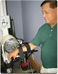 Hand Therapy - Man with arm in therapy machine