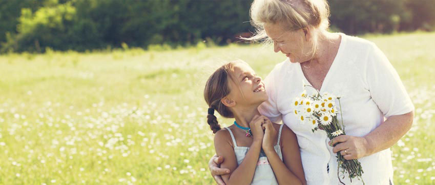 Banner: Heart Center - Grandmother & grandchild in grassy pasture